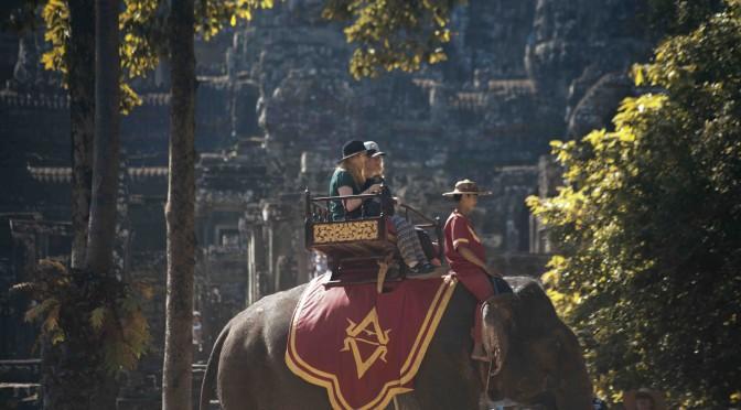 Tourists riding an elephant at Bayon, Angkor Thom